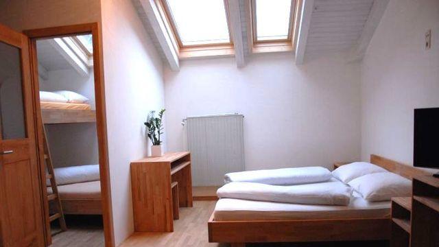 Organic shared room with roof window